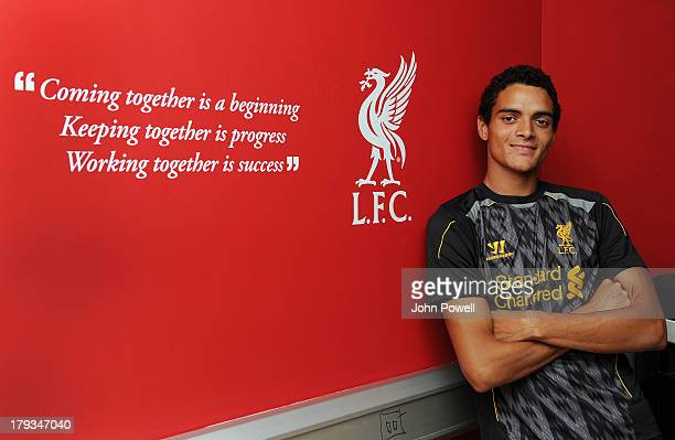 Tiago Ilori signs a contract for Liverpool Football Club at Melwood Training Ground on September 31 2013 in Liverpool United Kingdom