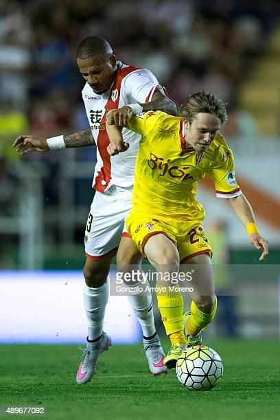 Tiago Manuel Dias Correia alias Bebe of Rayo Vallecano de Madrid grabs holds Alen Halilovic of Real Sporting de Gijon during the La Liga match...
