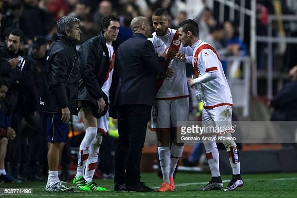Tiago Manuel Dias Correia alias Bebe of Rayo Vallecano de Madrid listens to his head coach Paco Jemez during the La Liga match between Rayo Vallecano...