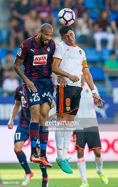 Tiago Manuel Dias Correia '' Bebe '' of SD Eibar duels for the ball with Enzo Perez of Valencia CF during the La Liga match between SD Eibar and...