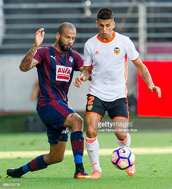 Tiago Manuel Dias Correia '' Bebe '' of SD Eibar duels for the ball with Joao Cancelo of Valencia CF during the La Liga match between SD Eibar and...
