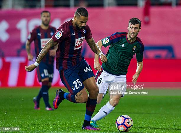 Tiago Manuel Dias Correia '' Bebe '' of SD Eibar duels for the ball with Oier Sanjurjo of CA Osasuna during the La Liga match between SD Eibar and CA...