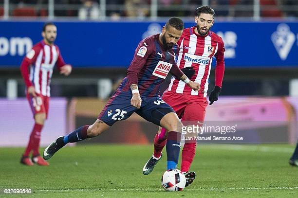 Tiago Manuel Dias Correia 'Bebe' of SD Eibar duels for the ball with Yannick FerreiraCarrasco of Atletico Madrid during the Copa del Rey Quarter...