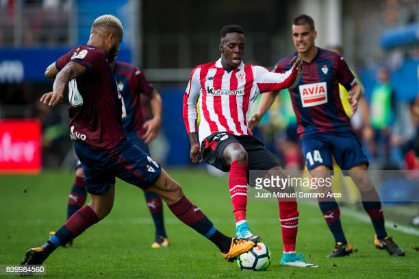 Tiago Manuel Dias Correia 'Bebe' of SD Eibar duels for the ball with Inaki Willams of Athletic Club during the La Liga match between SD Eibar and...