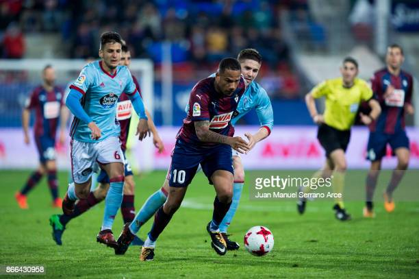Tiago Manuel Dias Correia 'Bebe' of SD Eibar duels for the ball with Imanol Sarriegui of RC Celta de Vigo during the Copa Del Rey match between Eibar...