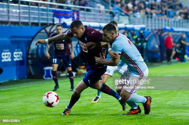 Tiago Manuel Dias Correia 'Bebe' of SD Eibar duels for the ball with Jonny Castro Otto of RC Celta de Vigo during the Copa Del Rey match between...
