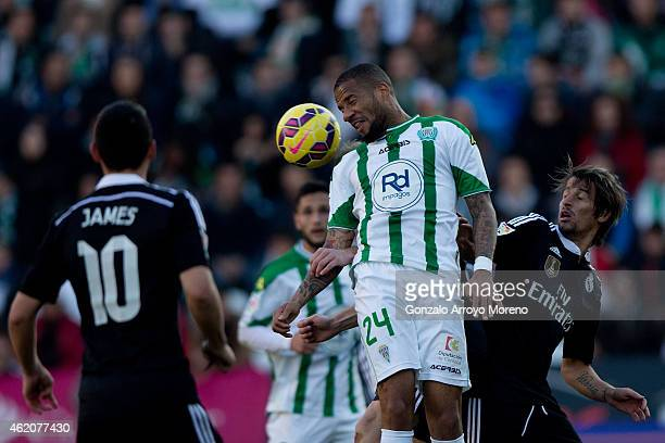Tiago Manuel Dias Correia of Cordoba CF wins the header after Fabio Coentrao of Real Madrid CF during the La Liga match between Cordoba CF and Real...