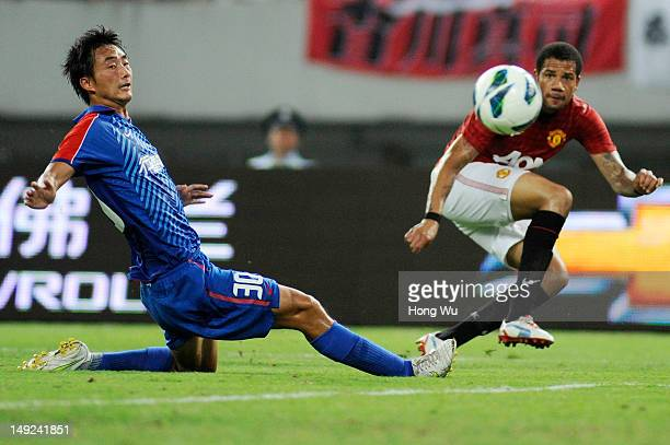 Tiago Manuel Dias Correia of Manchester United challenges with Tao Jin of Shanghai Shenhua during the Friendly Match between Shanghai Shenhua and...