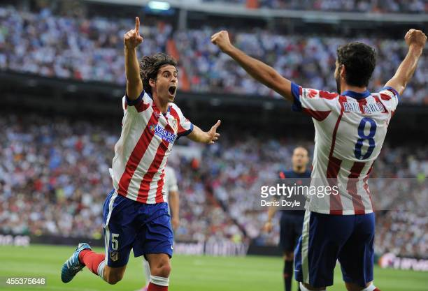 Tiago Mendes of Atletico de Madrid celebrates after scoring his team's opening goal during the La Liga match between Real Madrid and Atletico de...