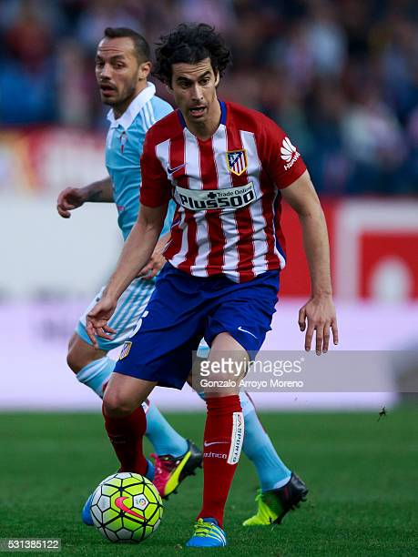 Tiago Mendes of Atletico de Madrid controls the ball ahead Marcelo Diaz of RC Celta de Vigoduring the La Liga match between Club Atletico de Madrid...