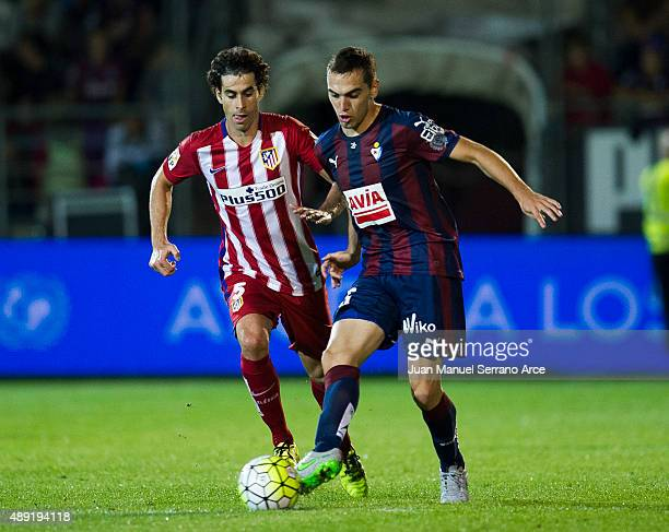 Tiago Mendes of Atletico de Madrid duels for the ball with Gonzalo Escalante of SD Eibar during the La Liga match between SD Eibar andÊAtletico de...