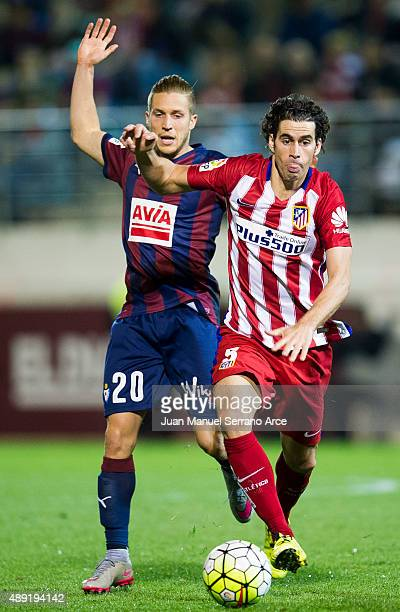 Tiago Mendes of Atletico de Madrid duels for the ball with Sergio Gontan of SD Eibar during the La Liga match between SD Eibar andÊAtletico de...