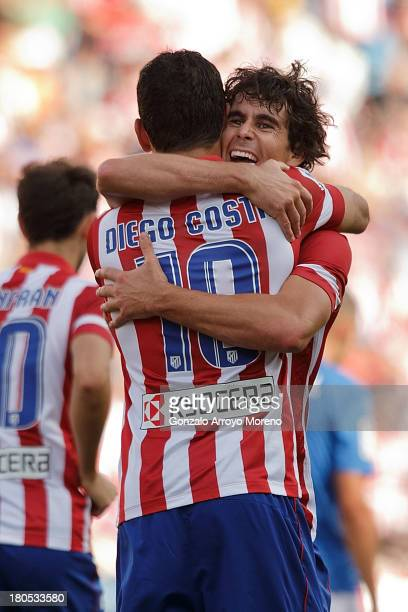 Tiago Mendes of Atletico de Madrid embraces his teammate Diego Costa after scoring their third goal during the La Liga match between Club Atletico de...