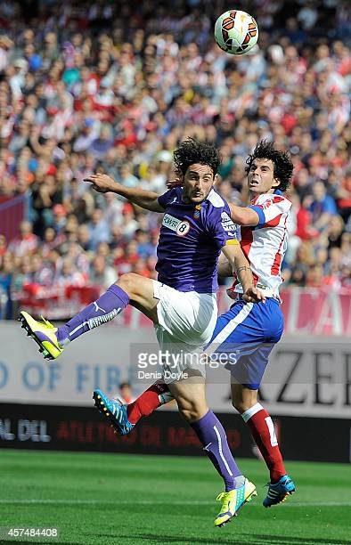 Tiago Mendes of Club Atletico de Madrid battles for the ball against Diego Colotto of RCD Espanyol during the La Liga match between Club Atletico de...