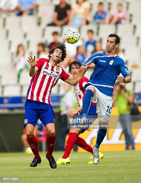 Tiago Mendes of Club Atletico de Madrid duels for the ball with Miguel Linares of Real Oviedo during a pre season friendly match between Real Oviedo...