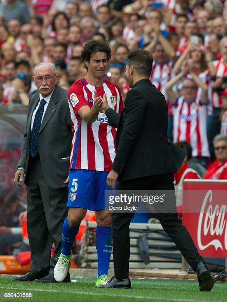 Tiago Mendes of Club Atletico de Madrid is greeted by his manager Diego Simeone in being substituted during the La Liga match between Club Atletico...