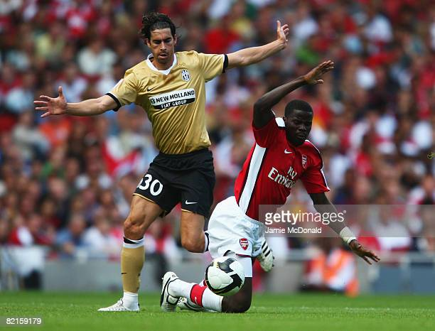 Tiago Mendes of Juventus challenges Emmanuel Eboue of Arsenal during the preseason friendly match between Arsenal and Juventus during the Emirates...