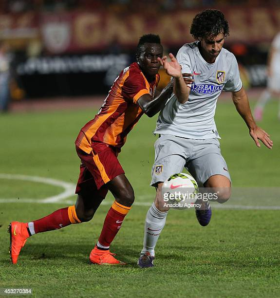 Tiago of Atletico Madrid and Bruma of Galatasaray fight for the ball during a friendly match between Galatasaray and Atletico Madrid organized as a...