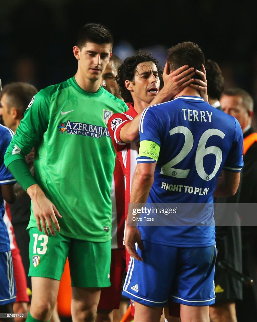 Tiago of Club Atletico de Madrid consoles John Terry of Chelsea as Thibaut Courtois (L) looks on after the UEFA Champions League semi-final second leg match between Chelsea and Club Atletico de Madrid at Stamford Bridge on April 30, 2014 in London, England.