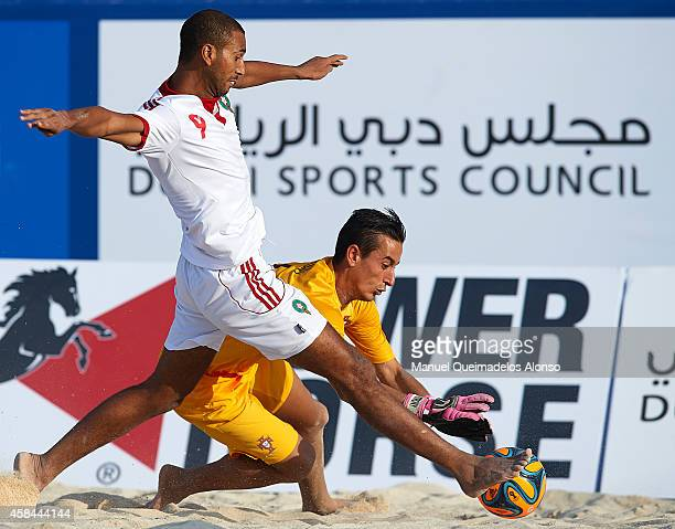 Tiago Petrony of Portugal competes for the ball with Azzeddine el Hamidy of Morocco during day two of the Beach Soccer Intercontinental Cup 2014...