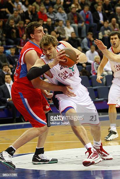 Tiago Splitter #21 of Caja Laboral competes with Sasha Kaun #24 of CSKA Moscow during the Euroleague Basketball 20092010 Play Off Game 2 between CSKA...