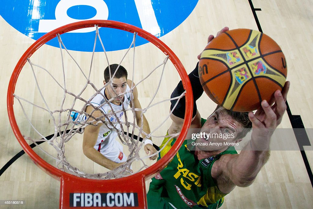 Tiago Splitter of Brazil shoots against Nemanja Bjelica of Serbia during the 2014 FIBA World Basketball Championship quarter final match between Serbia and Brazil at Palacio de los Deportes on September 10, 2014 in Madrid, Spain.
