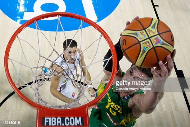 Tiago Splitter of Brazil shoots against Nemanja Bjelica of Serbia during the 2014 FIBA World Basketball Championship quarter final match between...