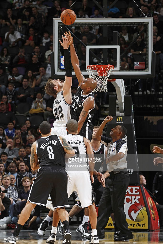 <a gi-track='captionPersonalityLinkClicked' href=/galleries/search?phrase=Tiago+Splitter&family=editorial&specificpeople=208218 ng-click='$event.stopPropagation()'>Tiago Splitter</a> #22 of the San Antonio Spurs and <a gi-track='captionPersonalityLinkClicked' href=/galleries/search?phrase=Jerry+Stackhouse&family=editorial&specificpeople=201683 ng-click='$event.stopPropagation()'>Jerry Stackhouse</a> #42 of the Brooklyn Nets battle for a jump ball on December 31, 2012 at the AT&T Center in San Antonio, Texas.