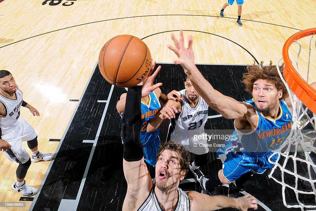 <a gi-track='captionPersonalityLinkClicked' href=/galleries/search?phrase=Tiago+Splitter&family=editorial&specificpeople=208218 ng-click='$event.stopPropagation()'>Tiago Splitter</a> #22 of the San Antonio Spurs and <a gi-track='captionPersonalityLinkClicked' href=/galleries/search?phrase=Robin+Lopez&family=editorial&specificpeople=2351509 ng-click='$event.stopPropagation()'>Robin Lopez</a> #15 of the New Orleans Hornets reach for a rebound during their game on December 21, 2012 at the AT&T Center in San Antonio, Texas.