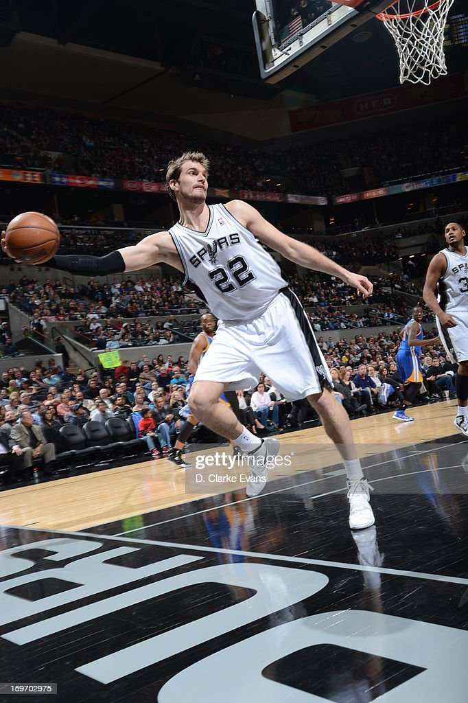 <a gi-track='captionPersonalityLinkClicked' href=/galleries/search?phrase=Tiago&family=editorial&specificpeople=208218 ng-click='$event.stopPropagation()'>Tiago</a> Splitter #22 of the San Antonio Spurs attempts to save the ball in a game against the Golden State Warriors on January 18, 2013 at the AT&T Center in San Antonio, Texas.