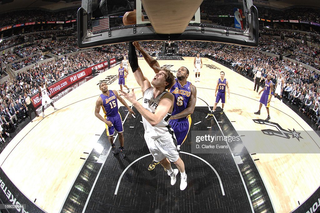 Tiago Splitter #22 of the San Antonio Spurs battle for the ball control with Earl Clark #6 of the Los Angeles Lakers during the game between the Los Angeles Lakers and the San Antonio Spurs on January 9, 2013 at the AT&T Center in San Antonio, Texas.