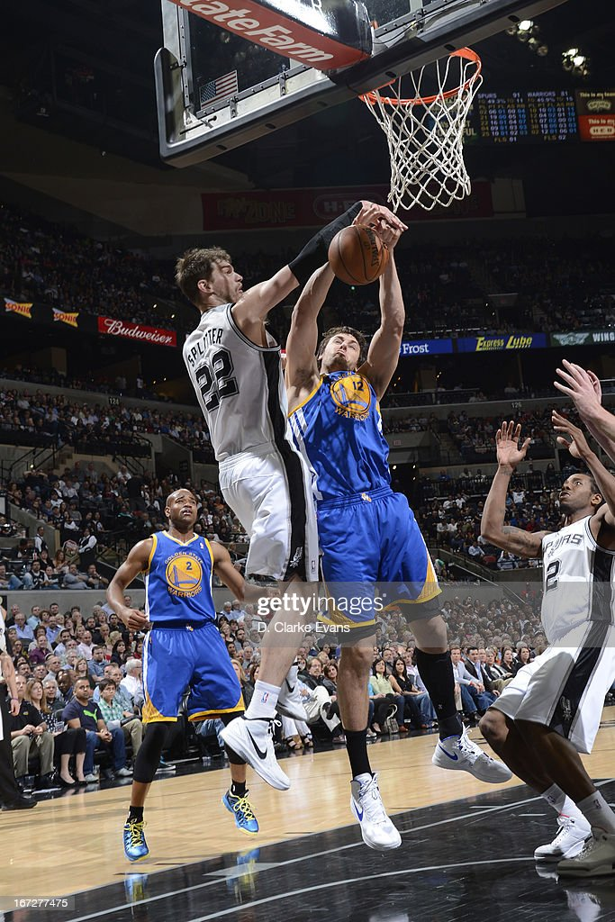 Tiago Splitter #22 of the San Antonio Spurs blocks the shot of Andrew Bogut #12 of the Golden State Warriors on March 20, 2013 at the AT&T Center in San Antonio, Texas.