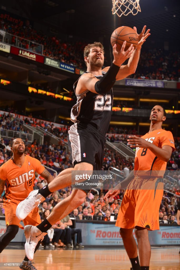 Tiago Splitter #22 of the San Antonio Spurs drives for a shot against the Phoenix Suns on February 21, 2014 at U.S. Airways Center in Phoenix, Arizona.