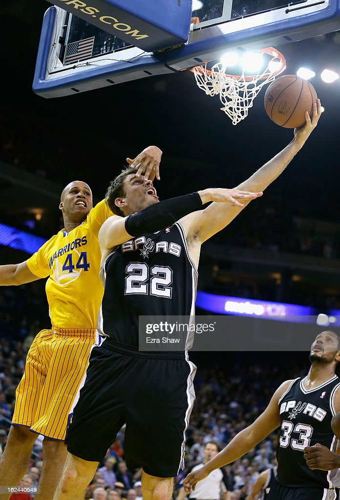 Tiago Splitter #22 of the San Antonio Spurs drives past Richard Jefferson #44 of the Golden State Warriors at Oracle Arena on February 22, 2013 in Oakland, California. The Warriors are wearing new short-sleeved uniforms for the first time. The Warriors won the game in overtime.