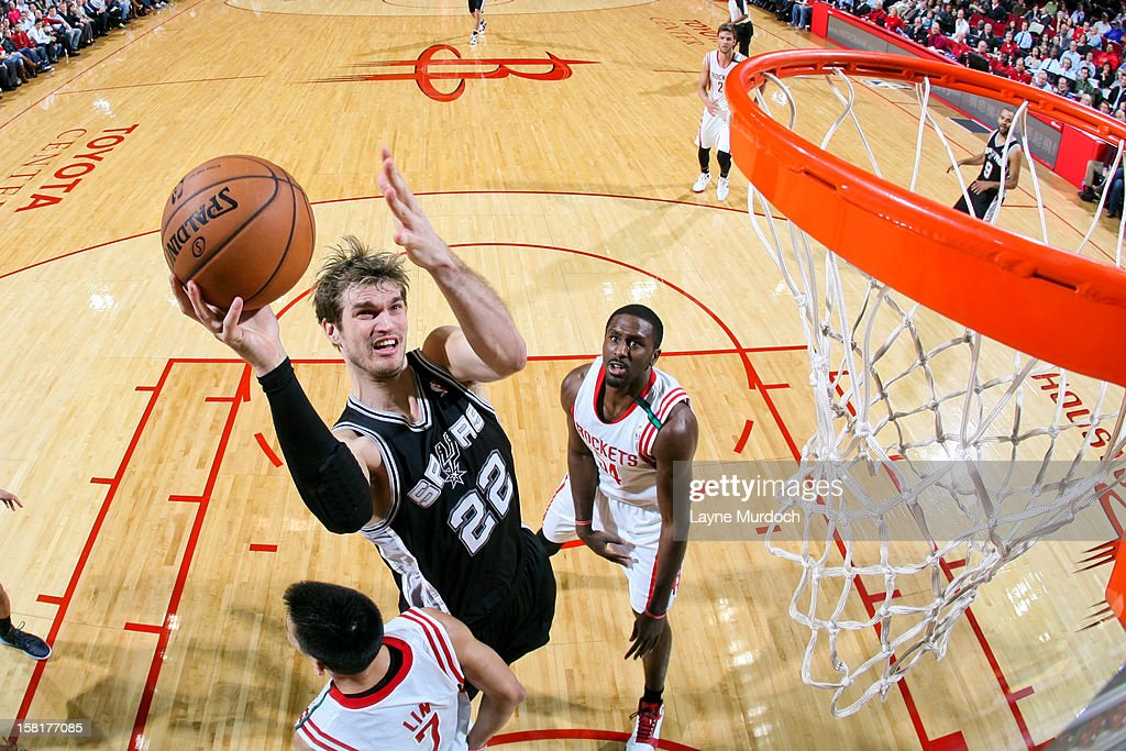 <a gi-track='captionPersonalityLinkClicked' href=/galleries/search?phrase=Tiago+Splitter&family=editorial&specificpeople=208218 ng-click='$event.stopPropagation()'>Tiago Splitter</a> #22 of the San Antonio Spurs drives to the basket against the Houston Rockets on December 10, 2012 at the Toyota Center in Houston, Texas.