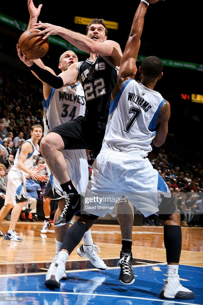 Tiago Splitter #22 of the San Antonio Spurs drives to the basket against Derrick Williams #7 and Greg Stiemsma #34 of the Minnesota Timberwolves on March 12, 2013 at Target Center in Minneapolis, Minnesota.