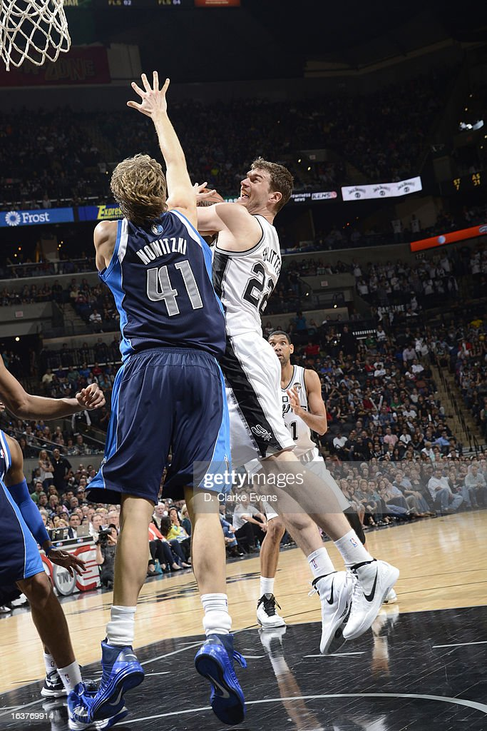Tiago Splitter #22 of the San Antonio Spurs drives to the basket against Dirk Nowitzki #41 of the Dallas Mavericks on March 14, 2013 at the AT&T Center in San Antonio, Texas.