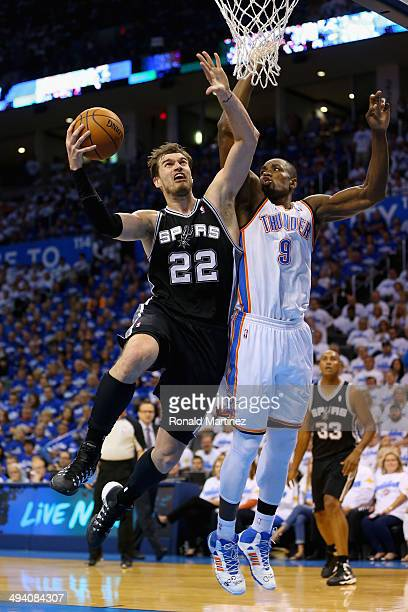 Tiago Splitter of the San Antonio Spurs drives to the basket against Serge Ibaka of the Oklahoma City Thunder in the second quarter during Game Four...