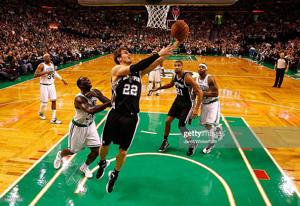Tiago Splitter #22 of the San Antonio Spurs drives to the basket for a layup in front of Brandon Bass #30 of the Boston Celtics during the game on November 21, 2012 at TD Garden in Boston, Massachusetts.