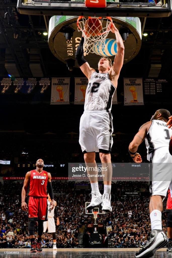 <a gi-track='captionPersonalityLinkClicked' href=/galleries/search?phrase=Tiago&family=editorial&specificpeople=208218 ng-click='$event.stopPropagation()'>Tiago</a> Splitter #22 of the San Antonio Spurs dunks against the Miami Heat during Game Three of the 2013 NBA Finals on June 11, 2013 at AT&T Center in San Antonio, Texas.