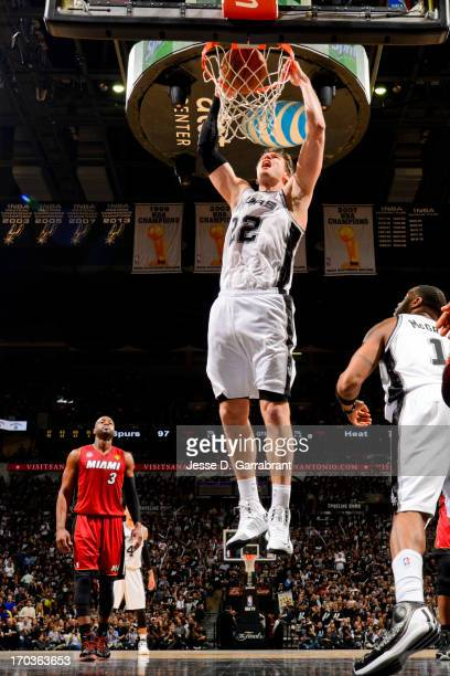 Tiago Splitter of the San Antonio Spurs dunks against the Miami Heat during Game Three of the 2013 NBA Finals on June 11 2013 at ATT Center in San...