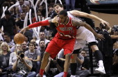 Tiago Splitter of the San Antonio Spurs fouls LaMarcus Aldridge of the Portland Trail Blazers in Game Five of the Western Conference Semifinals...