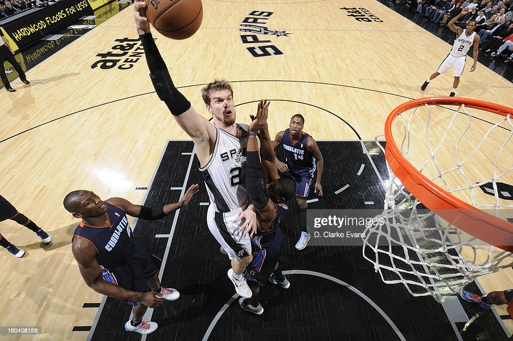 Tiago Splitter #22 of the San Antonio Spurs goes in for the short shot against the Charlotte Bobcats on January 30, 2013 at the AT&T Center in San Antonio, Texas.