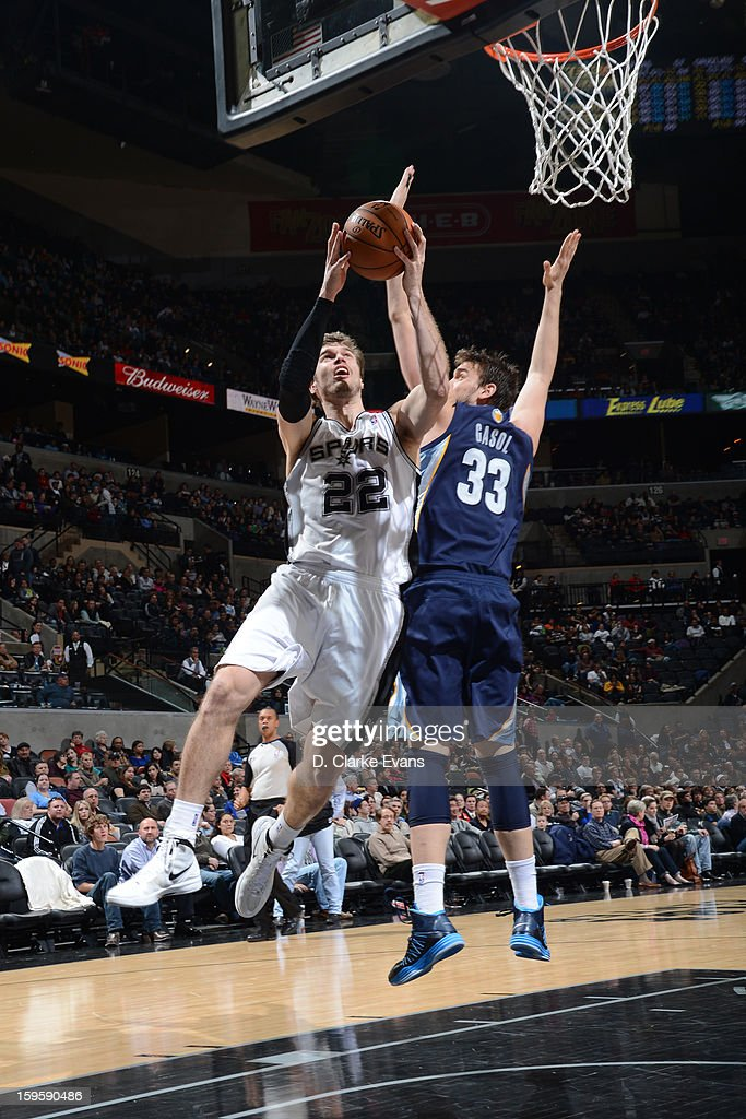 Tiago Splitter #22 of the San Antonio Spurs goes to the basket against Marc Gasol #33 of the Memphis Grizzlies on January 16, 2013 at the AT&T Center in San Antonio, Texas.