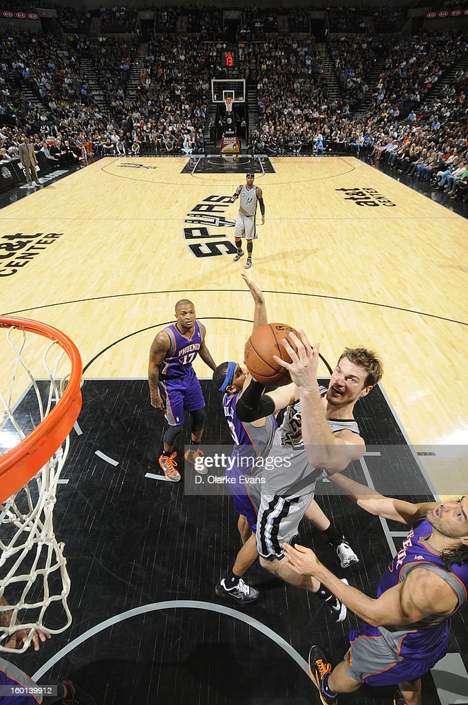 Tiago Splitter #22 of the San Antonio Spurs goes to the basket against the Phoenix Suns on January 26, 2013 at the AT&T Center in San Antonio, Texas.