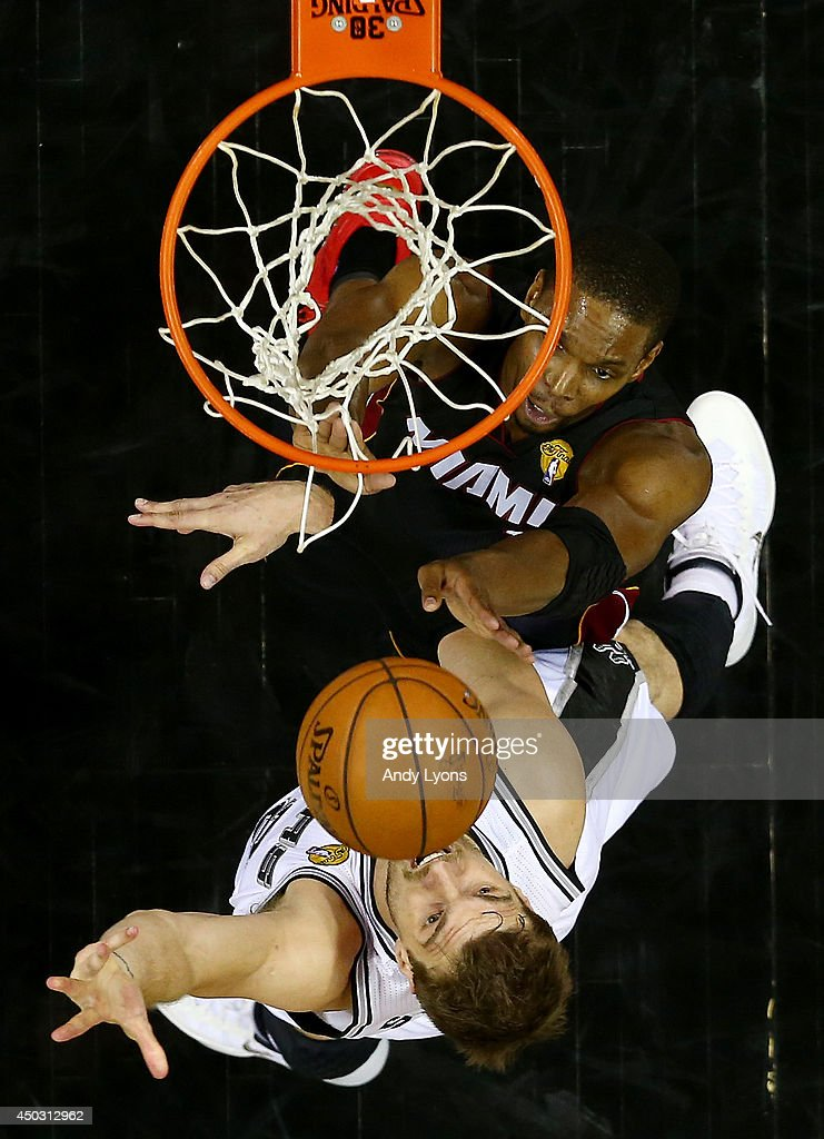 Tiago Splitter #22 of the San Antonio Spurs goes to the basket against Chris Bosh #1 of the Miami Heat during Game Two of the 2014 NBA Finals at the AT&T Center on June 8, 2014 in San Antonio, Texas.