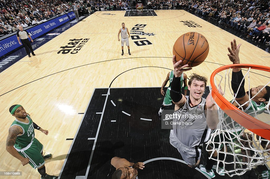 <a gi-track='captionPersonalityLinkClicked' href=/galleries/search?phrase=Tiago+Splitter&family=editorial&specificpeople=208218 ng-click='$event.stopPropagation()'>Tiago Splitter</a> #22 of the San Antonio Spurs goes to the basket during the game between the Boston Celtics and the San Antonio Spurs on December 15, 2012 at the AT&T Center in San Antonio, Texas.