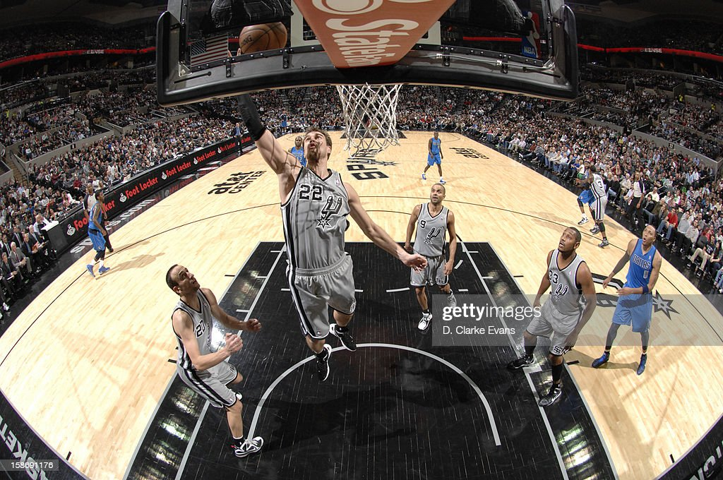 <a gi-track='captionPersonalityLinkClicked' href=/galleries/search?phrase=Tiago+Splitter&family=editorial&specificpeople=208218 ng-click='$event.stopPropagation()'>Tiago Splitter</a> #22 of the San Antonio Spurs goes to the basket during the game between the Dallas Mavericks and the San Antonio Spurs on December 23, 2012 at the AT&T Center in San Antonio, Texas.