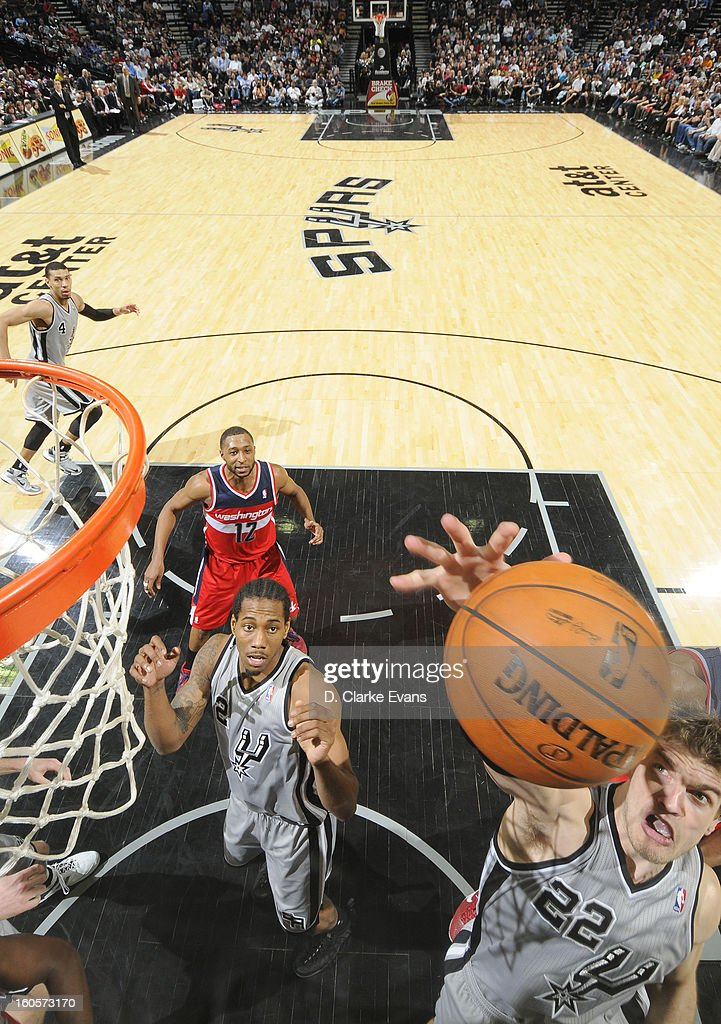 <a gi-track='captionPersonalityLinkClicked' href=/galleries/search?phrase=Tiago+Splitter&family=editorial&specificpeople=208218 ng-click='$event.stopPropagation()'>Tiago Splitter</a> #22 of the San Antonio Spurs goes to the basket during the game between the Washington Wizards and the San Antonio Spurs on February 2, 2013 at the AT&T Center in San Antonio, Texas.