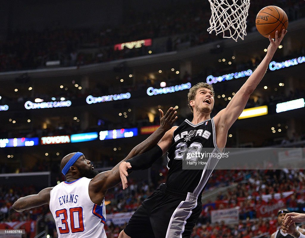 Tiago Splitter #22 of the San Antonio Spurs goes up for a shot against Reggie Evans #30 of the Los Angeles Clippers in the second quarter in Game Four of the Western Conference Semifinals in the 2012 NBA Playoffs on May 20, 2011 at Staples Center in Los Angeles, California.